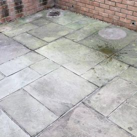 A patio that need cleaning