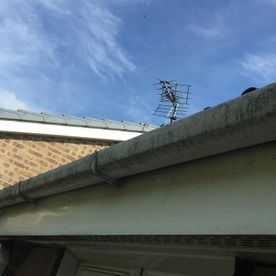 Guttering before being cleaned by our team