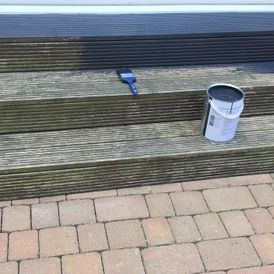 Decking steps being painted by our team